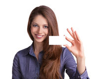 Cute girl showing a business card. In hand Stock Image