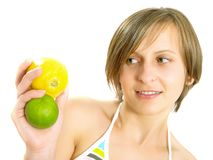 Cute girl showing citrus fruits Stock Photo
