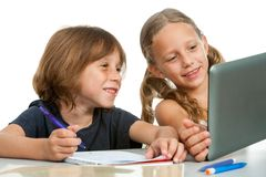 Cute girl showing classmate homework on tablet. Royalty Free Stock Photo