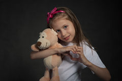 Cute girl showing heart shaped sign Stock Images