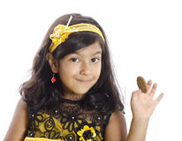 A cute girl showing her biscuit Royalty Free Stock Photography