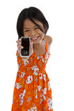 Cute girl showing her cellular phone Royalty Free Stock Images
