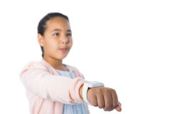 Cute girl showing her smart watch. Against white background Stock Photos