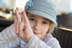 Cute girl showing horn signs Stock Photo