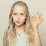 Cute girl showing OK. Cute young girl showing OK Stock Photo