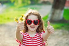 Cute girl showing thumbs up. Royalty Free Stock Images
