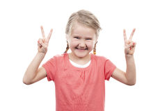 Cute girl showing victory sign Royalty Free Stock Photo