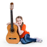 Cute girl sitting with acoustic guitar. Royalty Free Stock Image