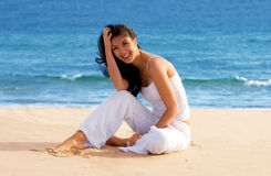 Cute Girl Sitting on the Beach Royalty Free Stock Photo
