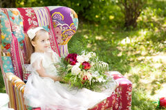Cute girl sitting in a bright vintage armchair Stock Photography