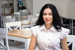 Cute girl sitting at cafe, work, study place. Close up portrait photo stock photo