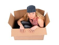 Cute girl sitting in a cardboard box Royalty Free Stock Image