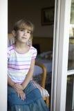 Cute girl sitting on chair on  veranda. Little cute girl sitting on chair on  veranda Royalty Free Stock Images