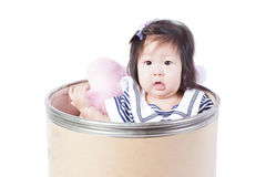 A cute girl sitting in a Chemical bucket Stock Images