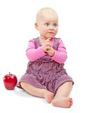 Cute girl sitting and clapping with red apple Stock Photography