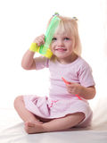 Cute girl sitting with combs Royalty Free Stock Image