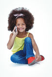 Cute girl sitting on floor having a phone call Stock Image