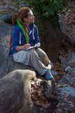 Cute Girl sitting in Forest and drawing sketch in her note book Stock Images