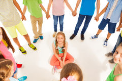 Cute girl sitting while kids reel Royalty Free Stock Images