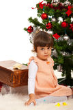 Cute girl sitting near Christmas tree Royalty Free Stock Images
