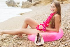 Cute girl is sitting on pink rubber ring Stock Photos