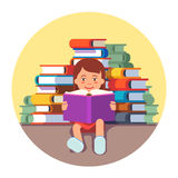 Cute girl sitting and reading a book Royalty Free Stock Photo