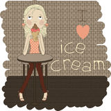 Cute girl sitting at the table eating ice cream. I Royalty Free Stock Images
