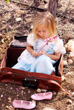 Cute girl  sitting in vintage bag Royalty Free Stock Photo