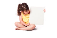Cute girl sitting with whiteboard Stock Images