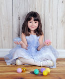 Cute Girl Sitting With Easter Eggs In Hands Stock Photos