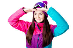 Cute girl in a ski suit Royalty Free Stock Image