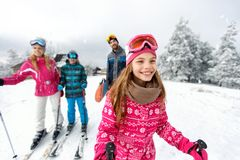 Girl skier skiing with family on mountain. Cute girl skier skiing with family on mountain Royalty Free Stock Photography