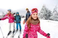 Girl skier skiing with family on mountain Royalty Free Stock Image