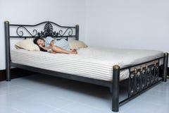 Cute girl sleep at large bed royalty free stock image