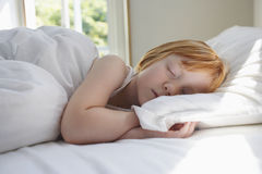 Cute Girl Sleeping In Bed Stock Photos