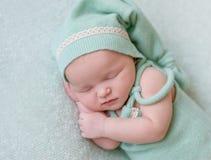 Cute girl sleeping in green hat, closeup Royalty Free Stock Image