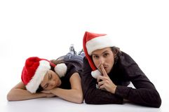 Cute girl sleeping and guy indicating for silent Stock Images
