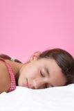 Cute girl sleeping on her bed Stock Images