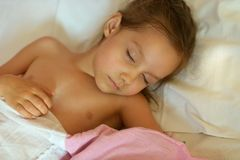 Cute Girl Sleeping In Bed Royalty Free Stock Images