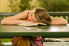 Cute girl sleeping on the table Stock Images