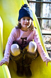 Cute Girl On a Slide Royalty Free Stock Photos