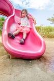 Cute Girl Sliding Down Stock Image
