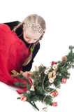 Cute girl with small christmas tree Stock Photos