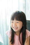 Cute girl smile happily. And look somewhere Royalty Free Stock Image