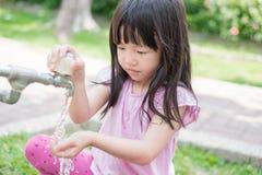 Girl washing hands Stock Image