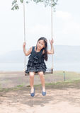 Cute girl smile and sit on swing seat. royalty free stock photos