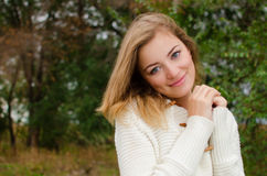 Cute girl. Cute smiling blondie girl in the park royalty free stock images