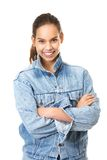 Cute girl smiling in blue denim jeans jacket. Portrait of a cute girl smiling in blue denim jeans jacket isolated on white background Stock Photo