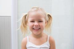 Cute girl smiling at camera Royalty Free Stock Photography