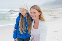 Cute girl with smiling mother at beach Royalty Free Stock Photos